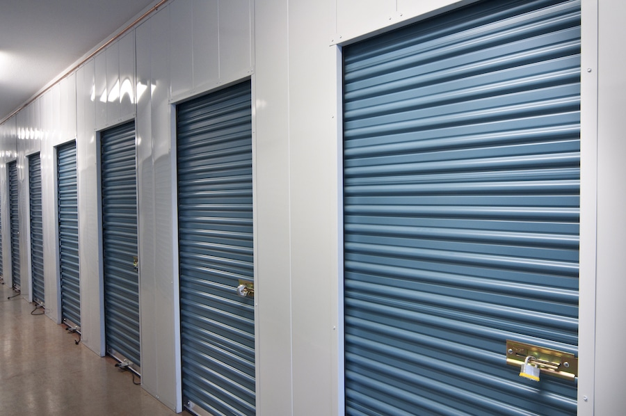 Indoor storage units with blue doors in Clinton Township, MI.