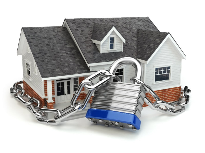 Close up of a 3d house with a padlock around it in Saint Clair Shores, MI.