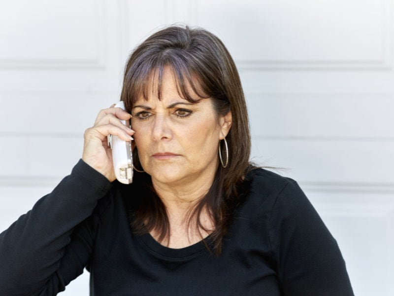 Angry mom on the phone waiting for her local locksmith company in Saint Clair Shores, MI.