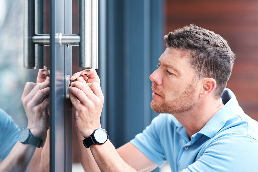 Shot of a handsome mature locksmith installing a lock.