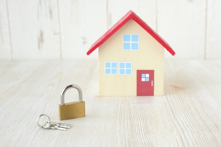 A small model house with a padlock sitting in front | Should You Have a Pro Locksmith Install Your Locks? | St. Clair Shores